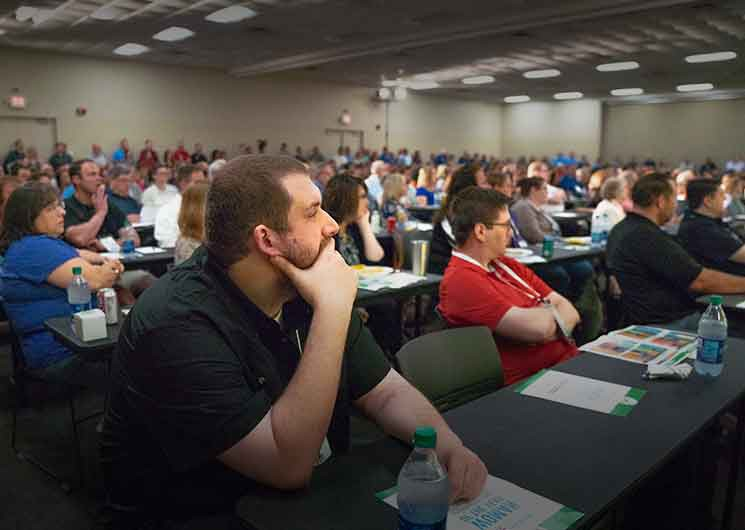 Room full of Heartland conference attendees watching a presentation